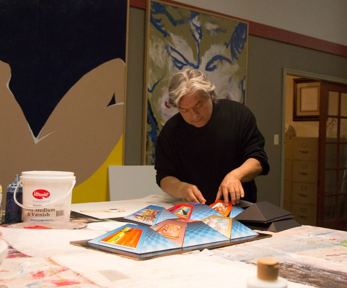 Dominic Pangborn works on an art-in-motion (AIM) piece of art at his studio in Detroit. His AIM works are a favorite among Park West Gallery collectors.