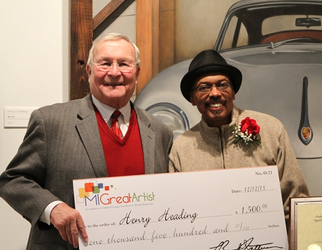 Oakland County Executive L. Brook Patterson presents last year's winner Henry Heading with a check. Contest winners and runners up have the opportunity for a multitude of prizes including expert framing, exhibitions of their artwork and small business classes.
