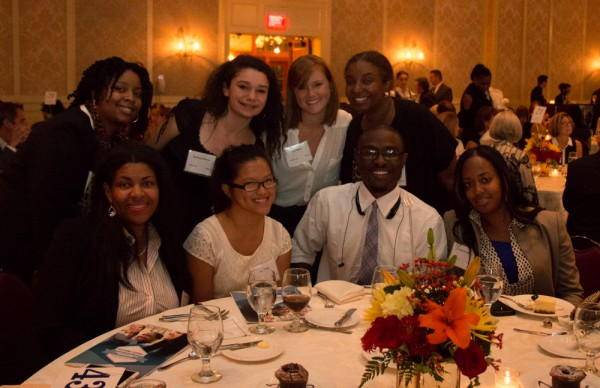 Park West Foundation director Saba Gebrai (top row, right) poses with youth affiliated the foundation's work to help local children aging out of foster care.