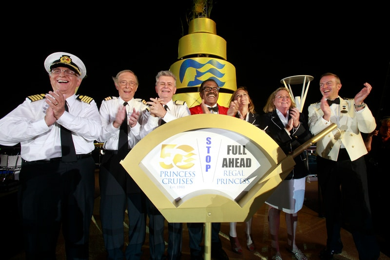 """The original cast of """"The Love Boat"""" (right to left: Captain Ed Perrin, Cynthia Lauren Tewes, Jill Whelan, Ted Lange, Fred Grandy, Bernie Kopell, and Gavin MacLeod) officially christened the Regal Princess at Port Everglades in Fort Lauderdale, Florida on Wednesday, Nov. 5, for its North American debut and naming ceremony. The ship's naming ceremony also marked the launch of Princess Cruises' year-long 50th anniversary celebration. (Photo Carlo Allegri/AP Images for Princess Cruises)."""