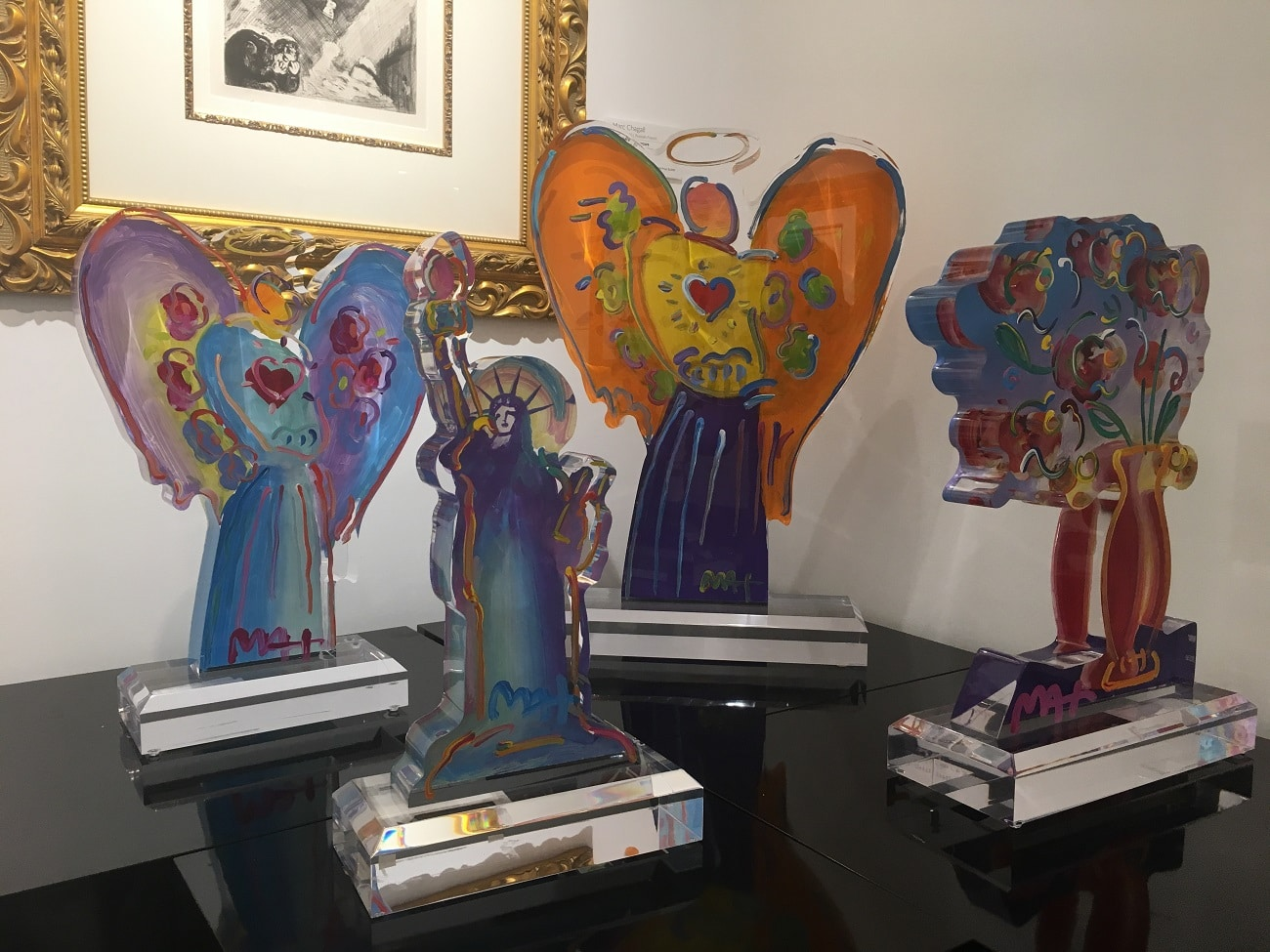 These acrylic sculptures by Peter Max would be ideal candidates for a lighted pedestal.