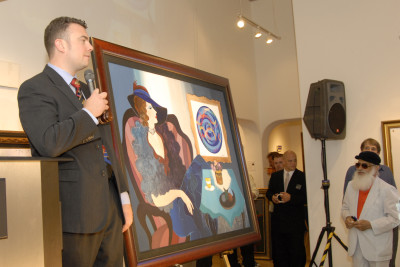 Rob auctioning at a special event featuring artist Yaacov Agam. Photo credit: Brent Plaxton