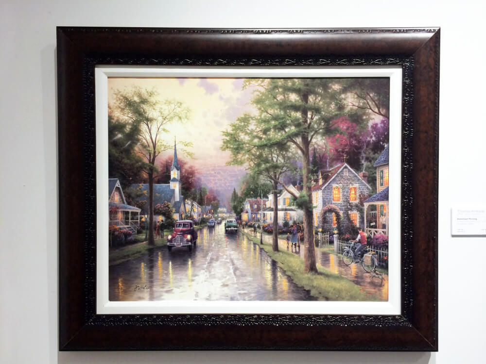 a dark frame brings out the light of this thomas kinkade art