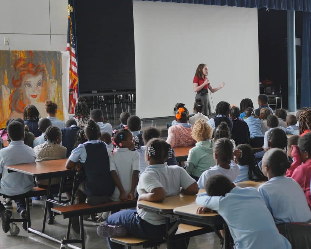 Autumn holds an assembly at Savoy Elementary school in Washington D.C. (Photo courtesy of Doug de Forest)