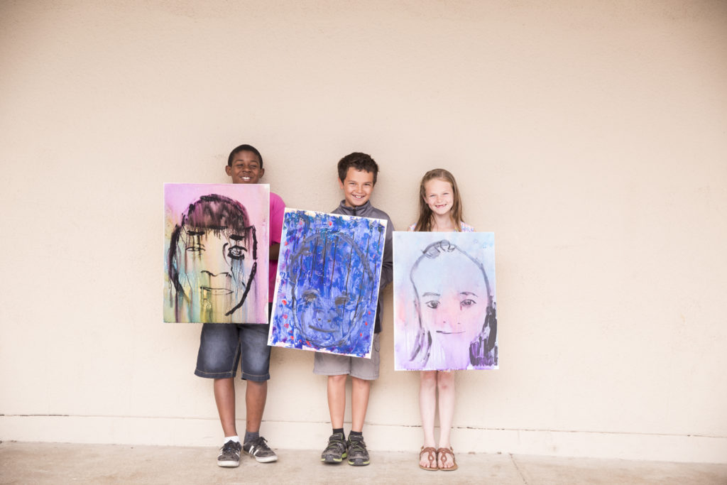 Students at Barton Elementary show off their student portraits. (Photo courtesy of Doug de Forest)