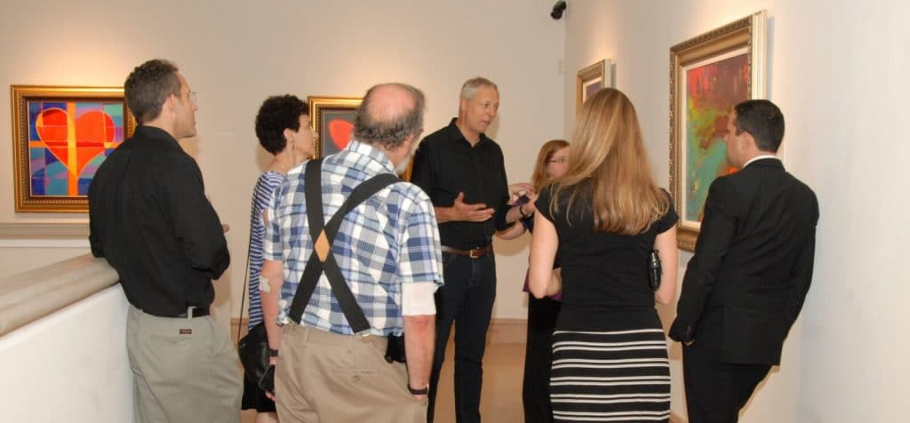 """Simon Bull discussing his artwork during his exhibition """"Language of Color."""""""