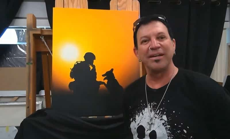 Michael Godard shows telecast viewers a new painting he's working on inspired by Dogs to Dog Tags