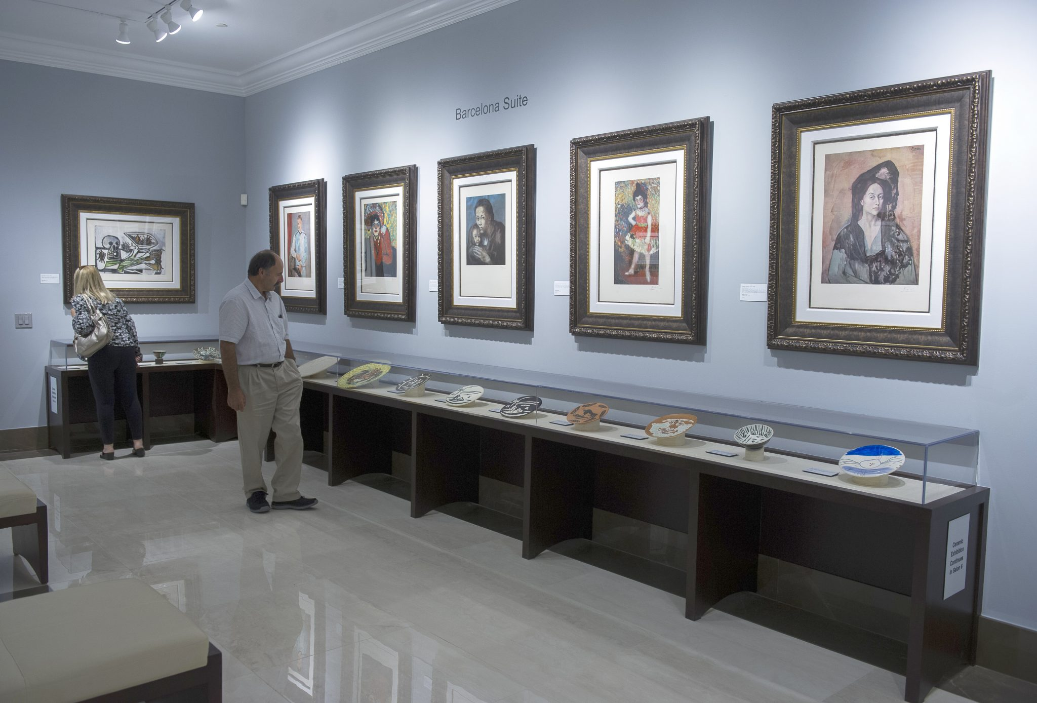 Two guests admiring Park West Gallery's permanent collection