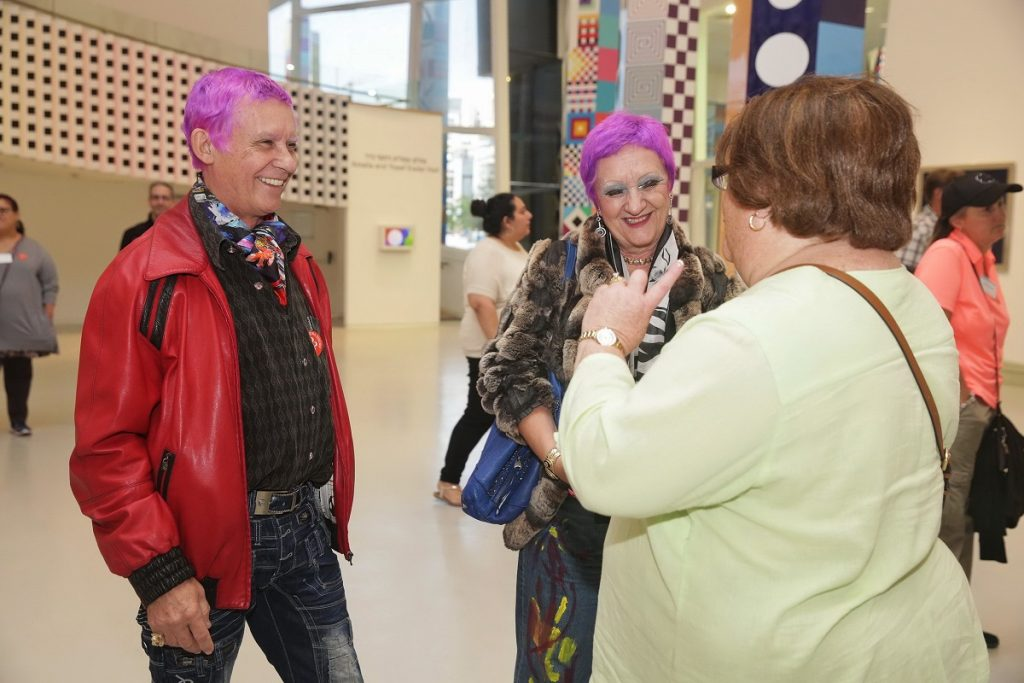 Artist Duaiv and his wife Magella greeting a Park West Gallery guest at YAMA (Photo by Shooka Cohen)