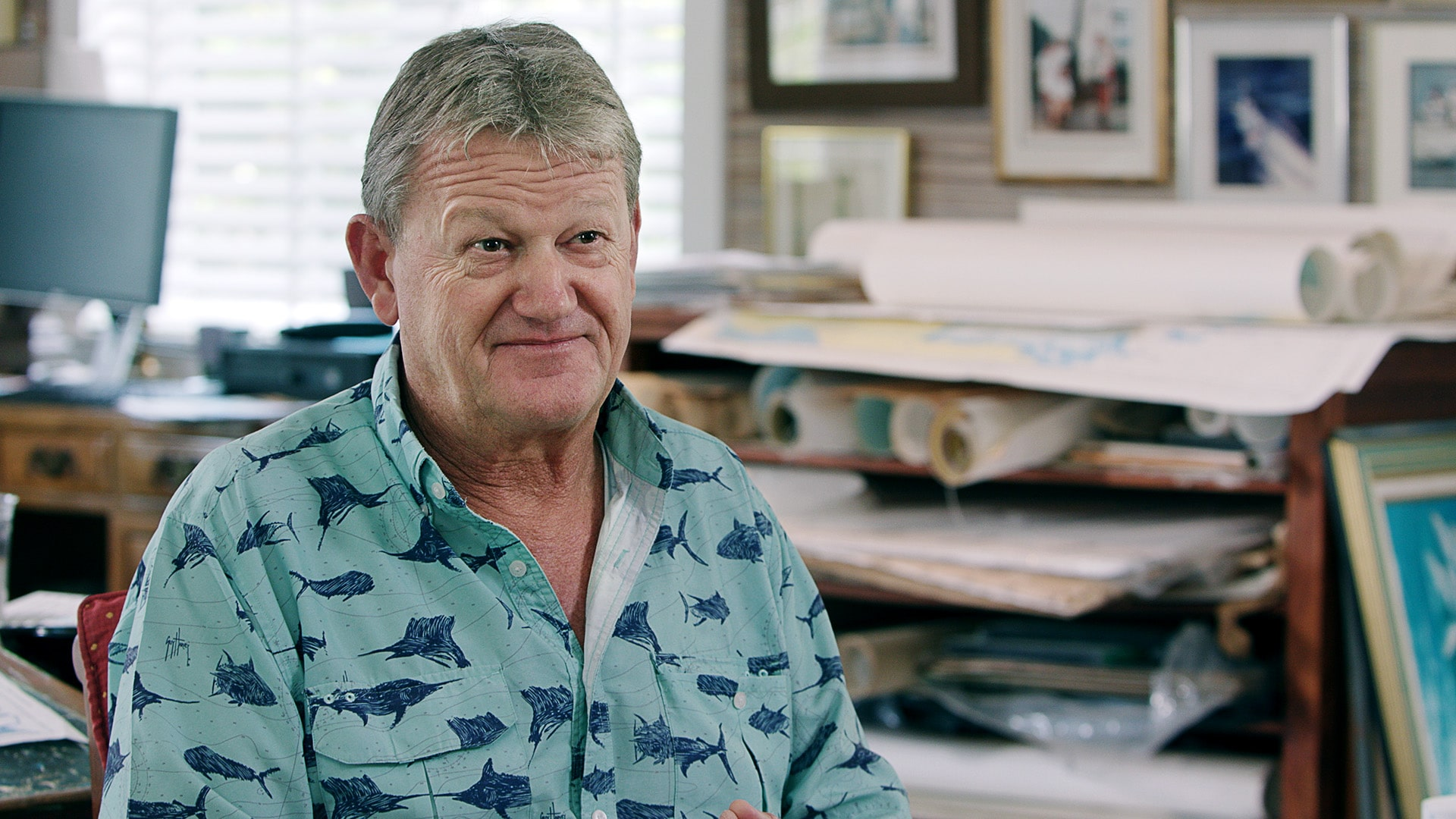 "Guy Harvey, wearing one of his trademark ""Guy Harvey shirts,"" at his studio in Grand Cayman, Guy Harvey art, Park West Gallery"