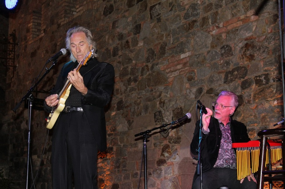 Gary Puckett playing at a Park West event, accompanied by Park West Gallery Director Morris Shapiro