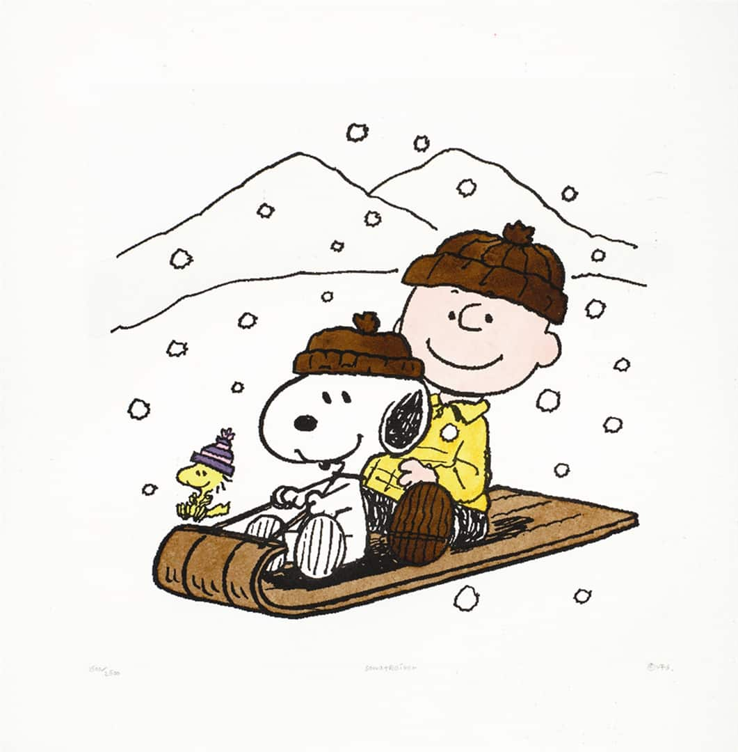 Charlie Brown and Snoopy riding a sled together through a snowy landscape