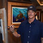 Wyland painting on board Norwegian Bliss, 2018. Wyland art
