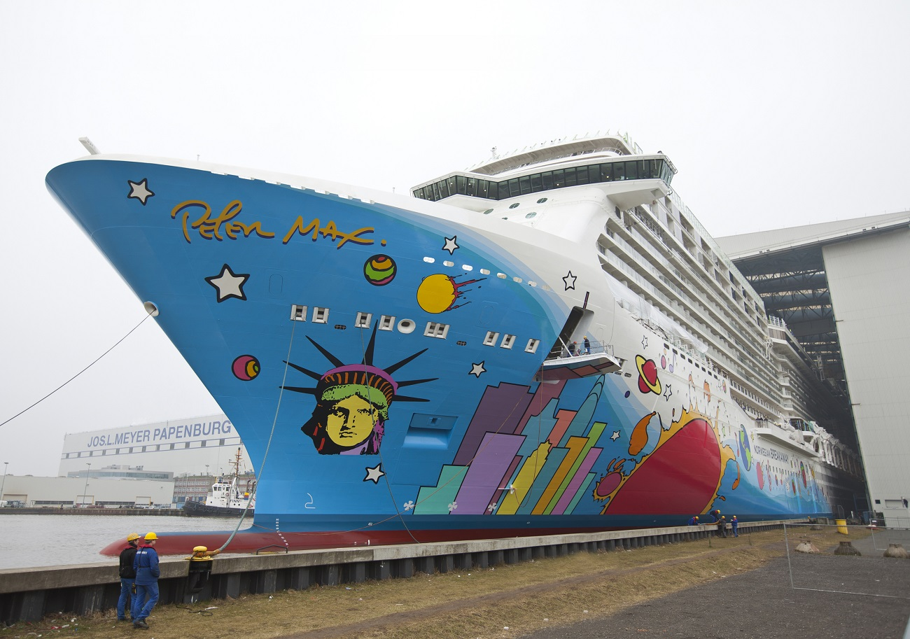 """Norwegian Breakaway—the """"Peter Max cruise ship""""—leaving the Meyer Werft shipyard in 2013. (Image courtesy of Meyer Werft)"""