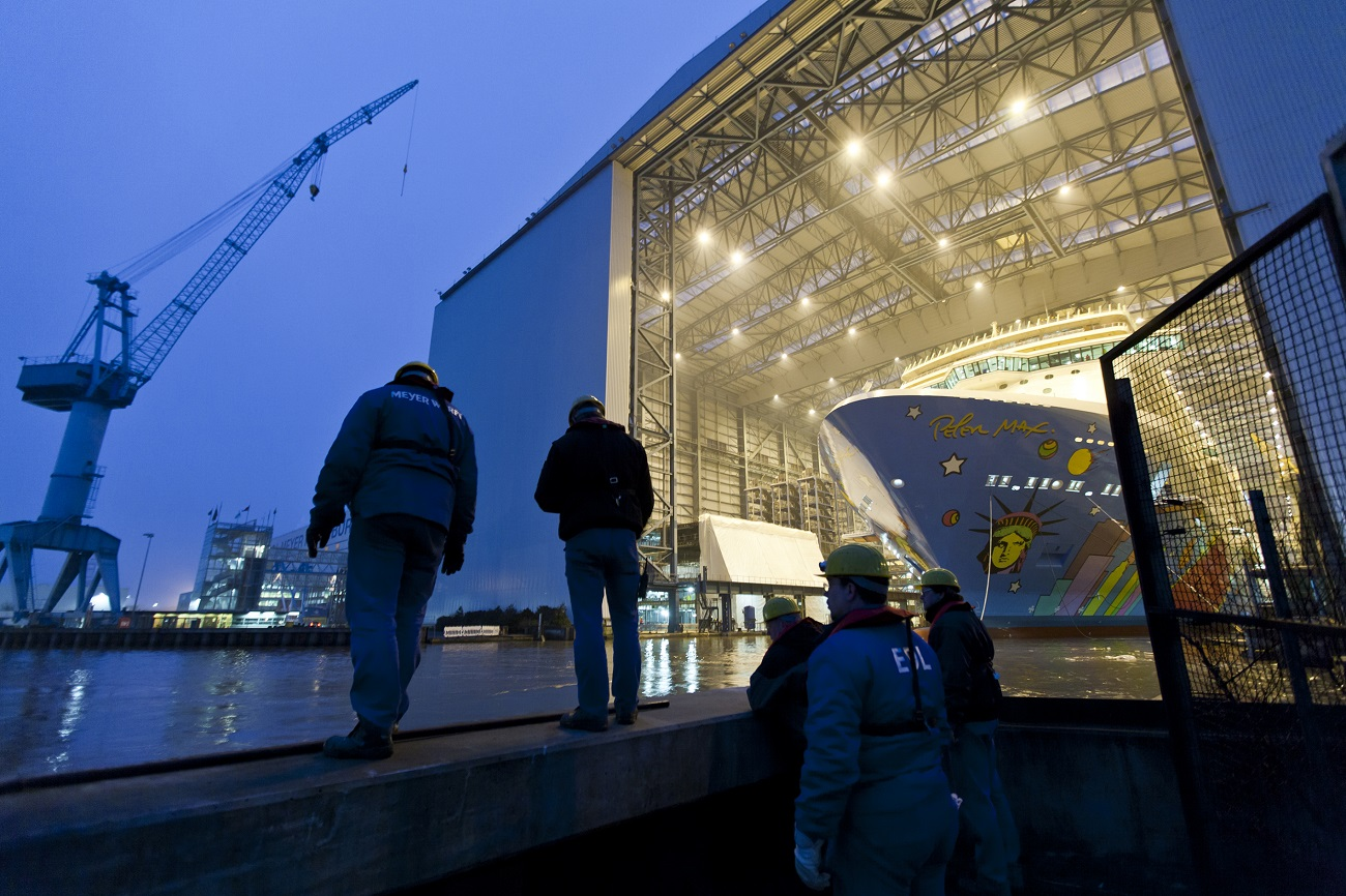 NCL Breakaway—a.k.a. the Peter Max cruise ship—prepares to leave the Meyer Werft shipyard in 2013. (Image courtesy of Meyer Werft)