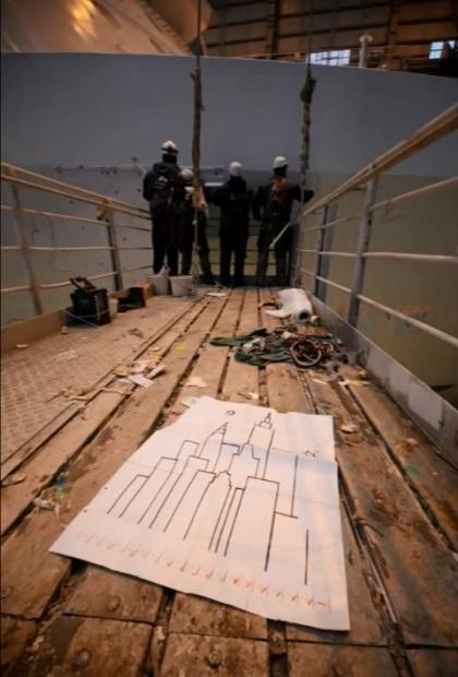 Artisans prepare to add Peter Max's iconic New York skyline to Breakaway's hull.