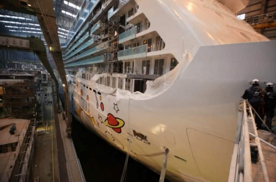 In progress shot of the Max hull art being applied in the Meyer Werft shipyard.