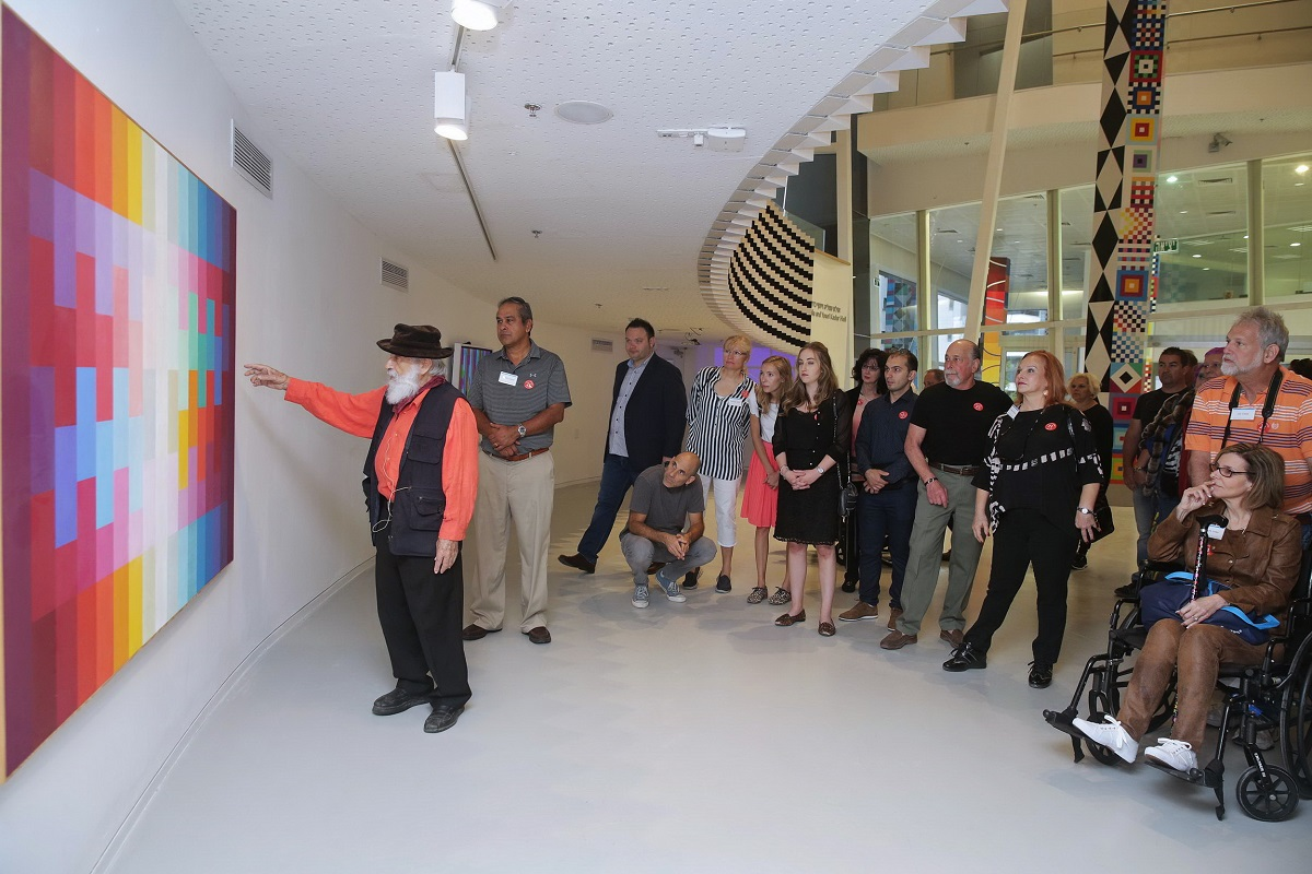 Agam gives guests a personal tour at the Yaacov Agam Museum of Art in 2017.