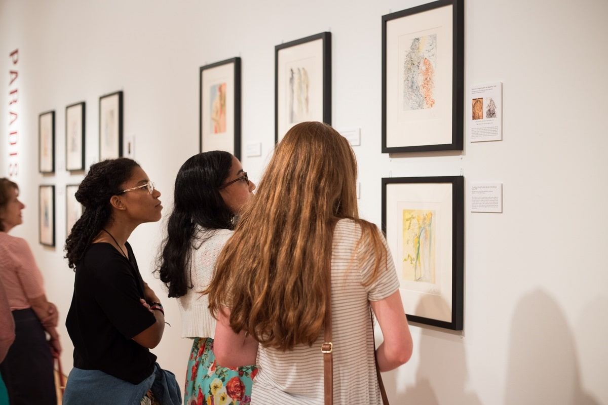 """Patrons at Louisiana's Hilliard University Art Museum explore Dalí's works at the opening for the exhibition """"Salvador Dalí's Stairway to Heaven."""""""