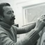 Pino working on one of his paintings.