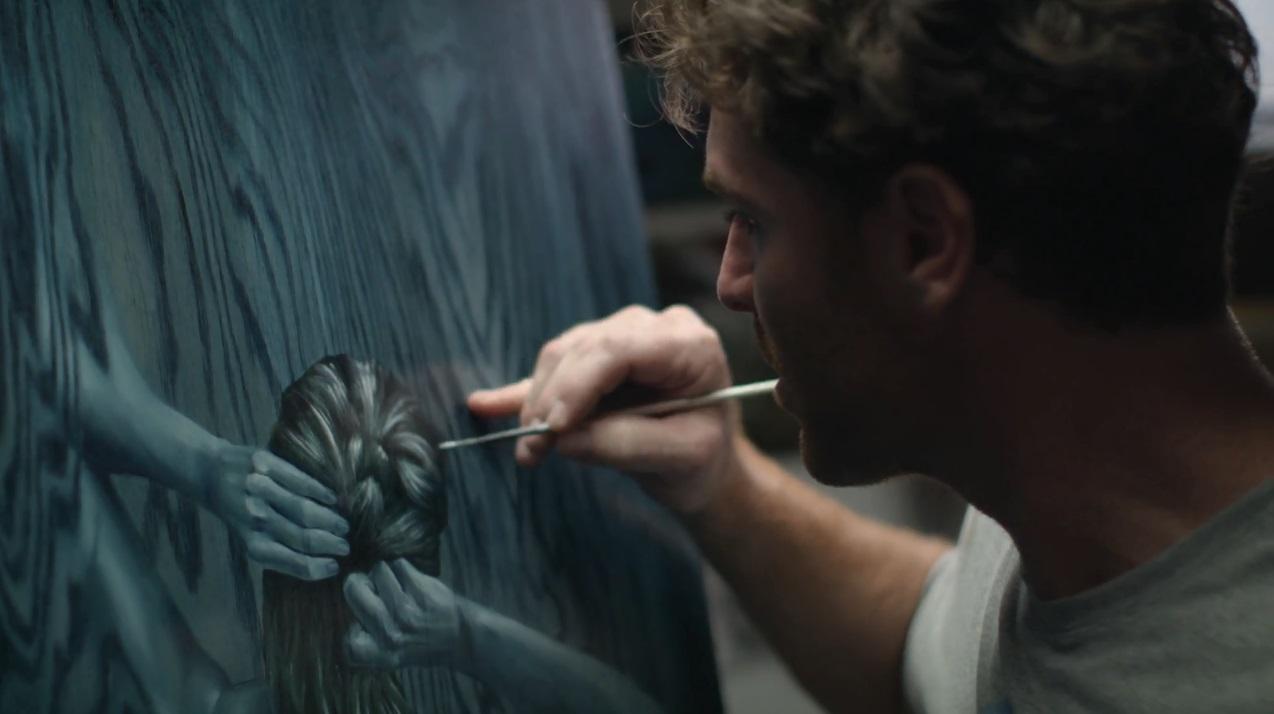 Matt Beyrer paints in his studio.
