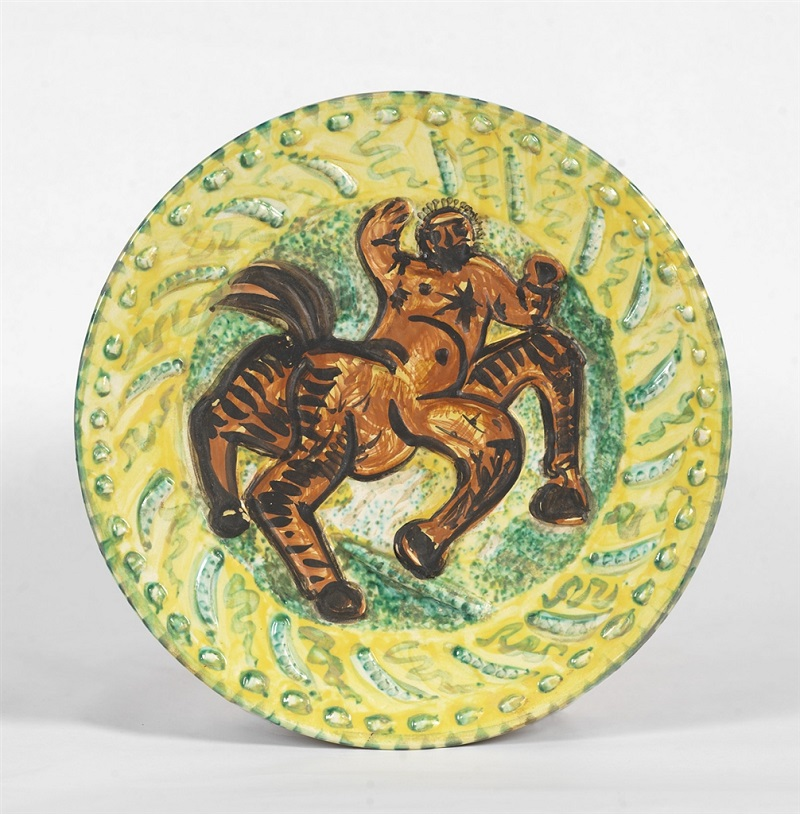 """Centaure"" (Centaur, 1956), Pablo Picasso. White earthenware clay round dish with colored engobe and partially brushed glazed. From the Picasso Ceramics collection at Park West Gallery."