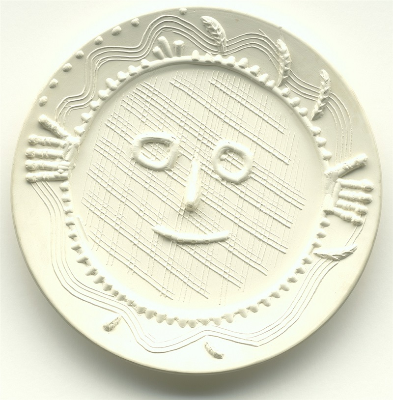 """""""Visage aux Mains"""" (Face with Hands; 1956), Pablo Picasso. White earthenware clay round dish. From the Picasso Ceramics collection at Park West Gallery"""