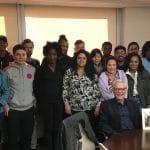Park West Gallery Director Morris Shapiro poses with SUNY's Kathryn W. Davis Global Community Scholars