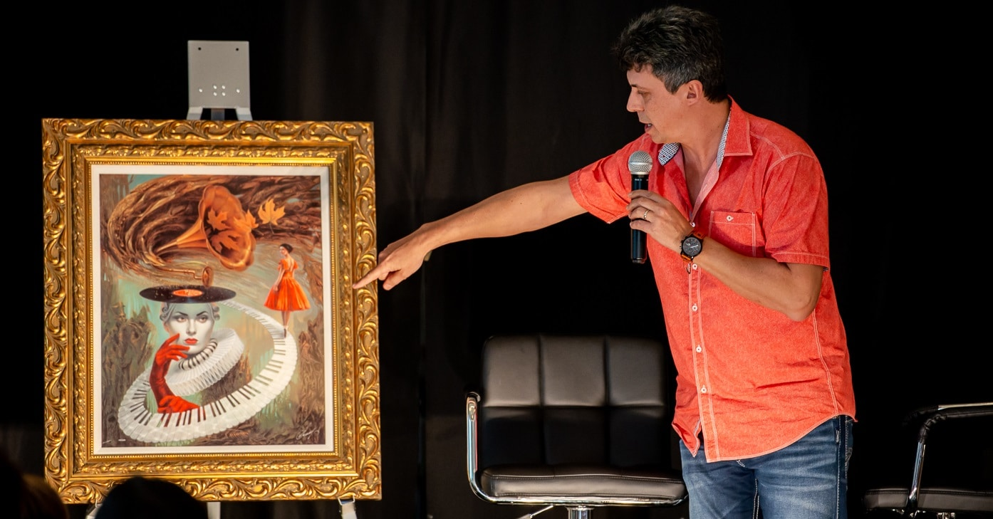 """Cheval """"explains"""" one of his designs to a crowd of Park West auctioneers."""