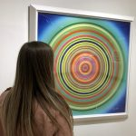 """A Park West visitor views Ron Agam's large-sized """"Endless Journey"""""""