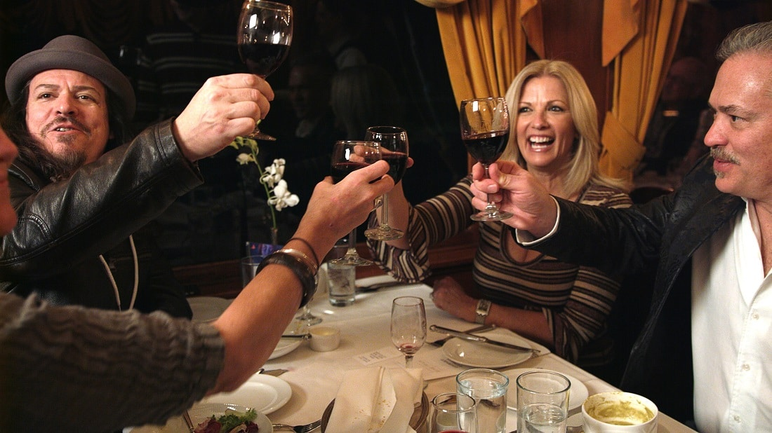 Artist Patrick Guyton (left) toasts Scott Jacobs and his wife at a Park West event in California's Napa Valley.