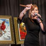 Auctioneer Nikki van der Merwe gets the crowd excited at a Park West auction.