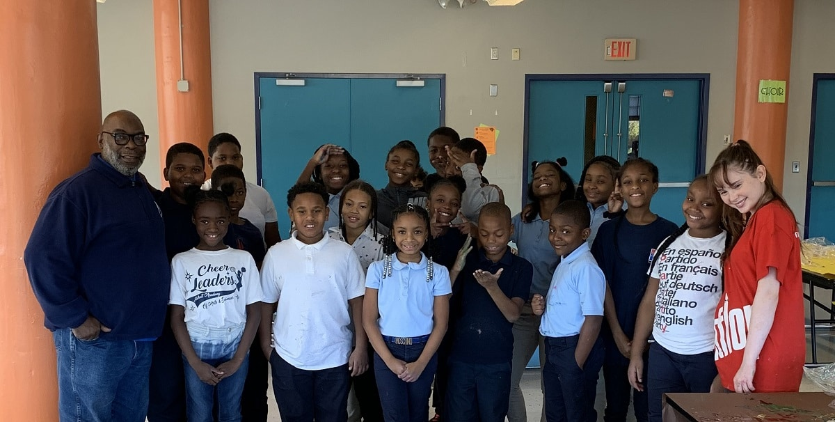 Autumn de Forest poses with one of her art classes at the Detroit Academy of Arts & Sciences