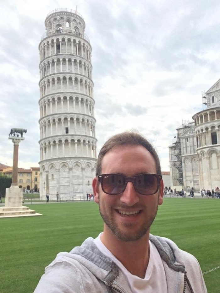 Henry-John enjoying the Leaning Tower of Pisa during his travels as an auctioneer.