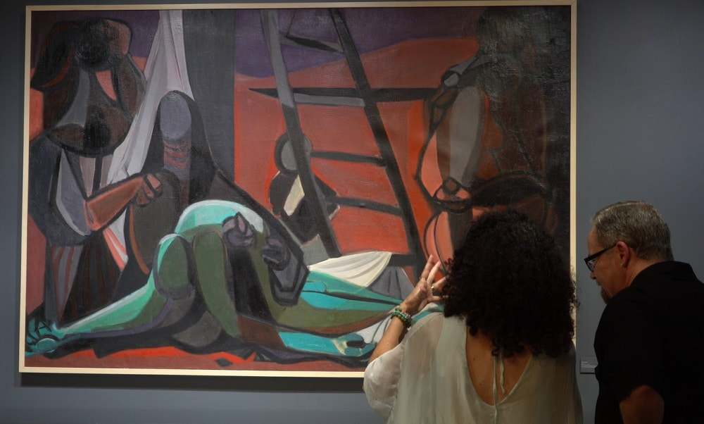 Monthaven patrons admire a work by Marcel Mouly.