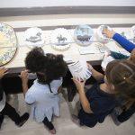 Local schoolchildren on a field trip enjoy Park West's collection of Picasso ceramics.