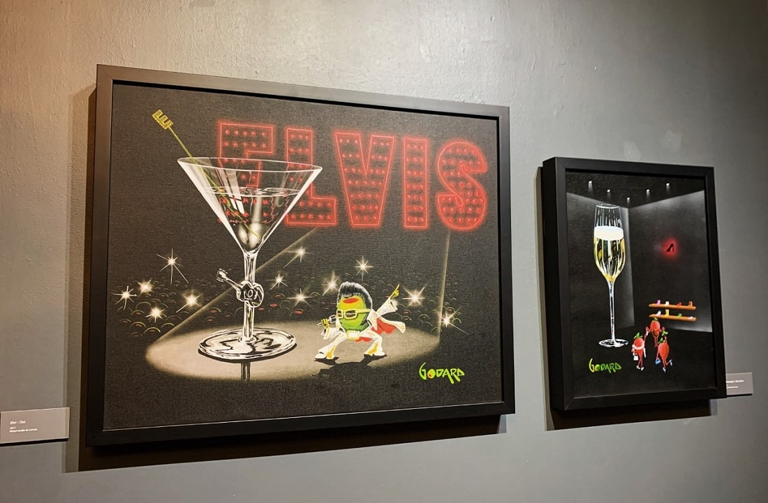 """Godard's """"Elvi-Tini"""" painting is a perfect fit for the Vegas-theme of """"The Secret Life of Olives."""""""