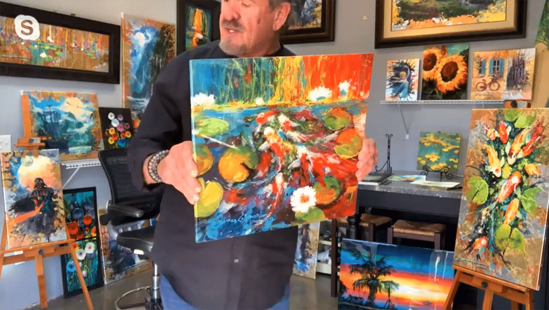 James Coleman holds a painting up to the camera