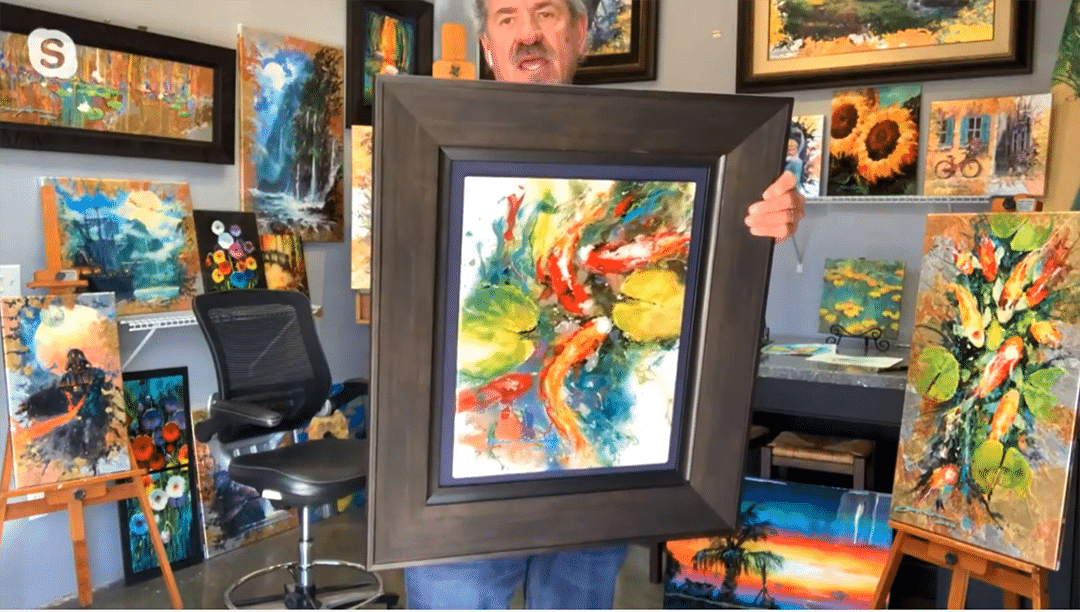 James Coleman shows a large framed painting to the camera
