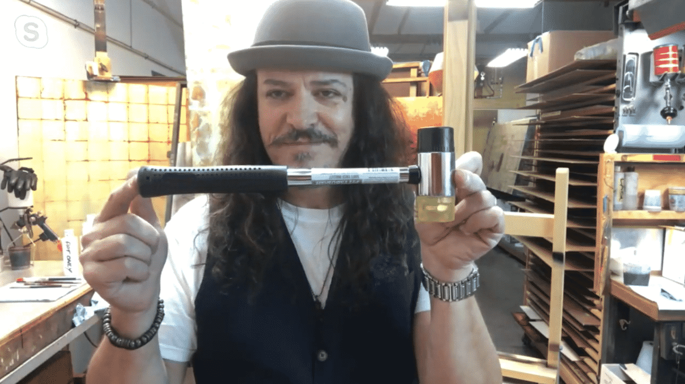 Patrick Guyton shows off his newest artistic invention in his studio