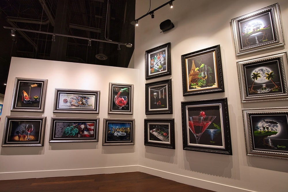 Just a few of the Michael Godard works on display at Park West Vegas.