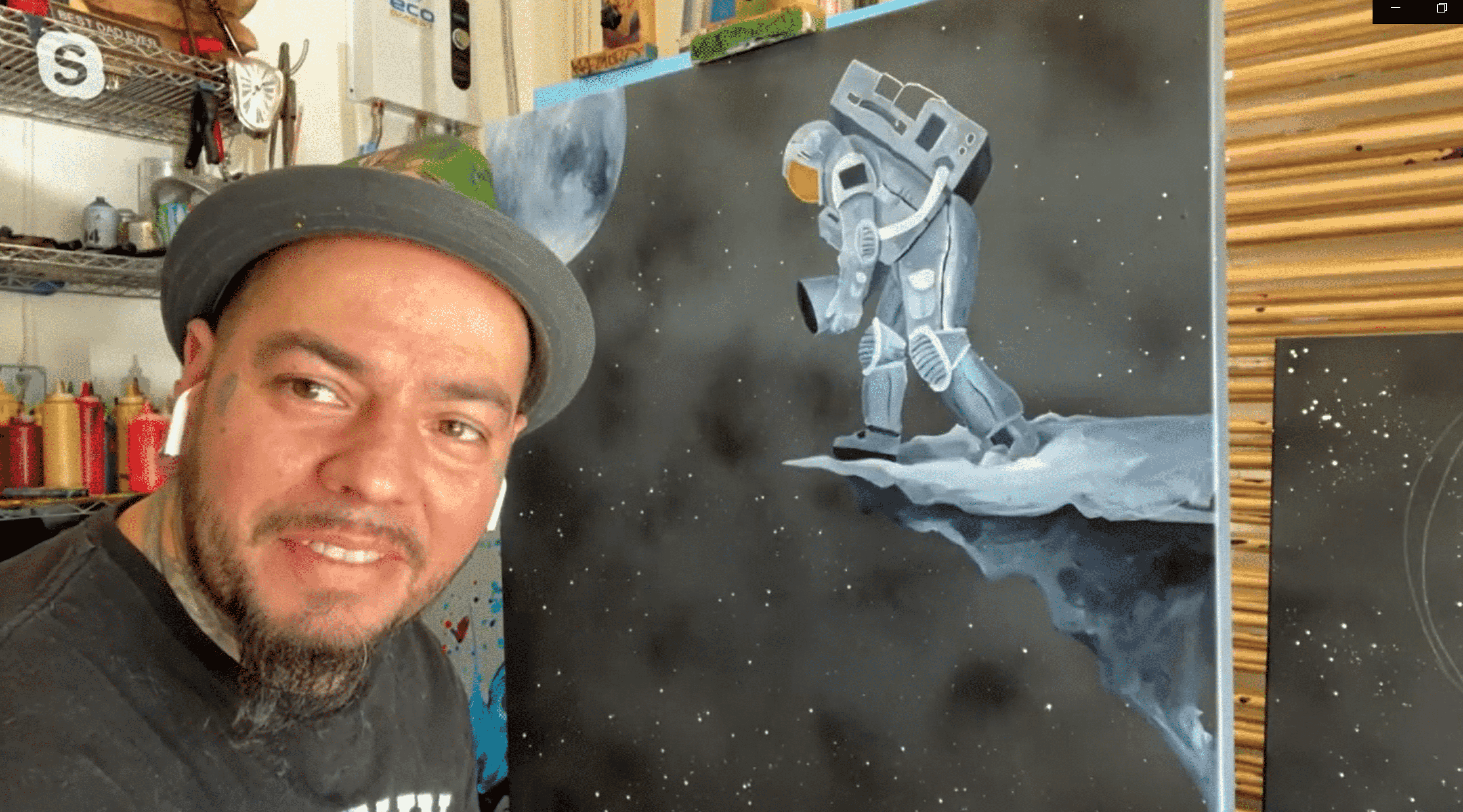 Abstract Artist Kre8 on a skype call in his studio